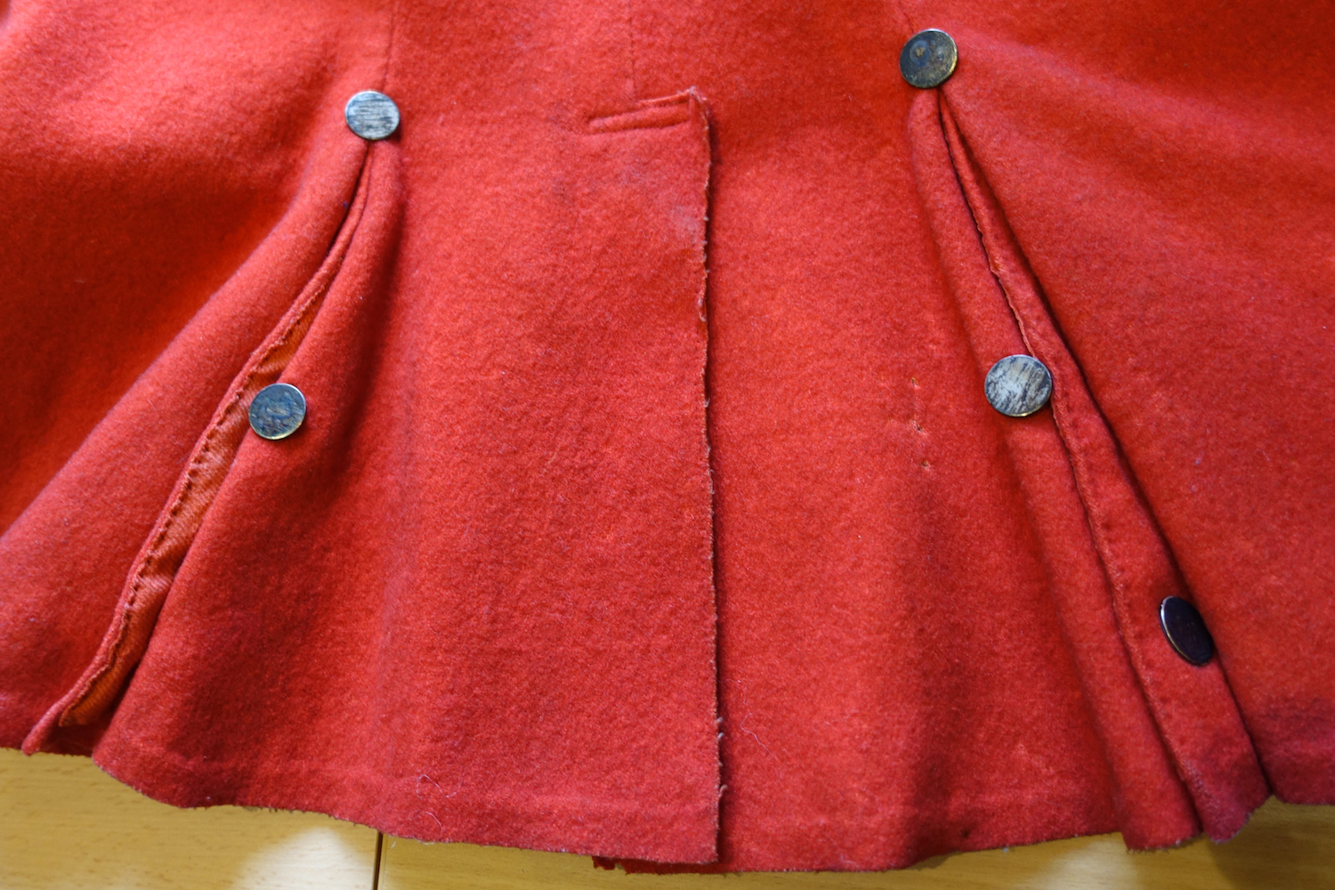 Close up of red riding coat
