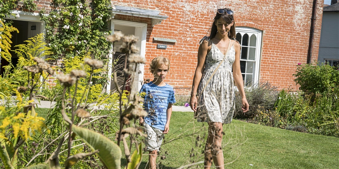 A mother and her young son walking in the gardens at Jane Austen's House