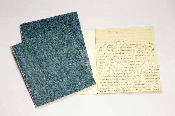 Cassandra's handwritten copy of Sanditon in three green notebooks