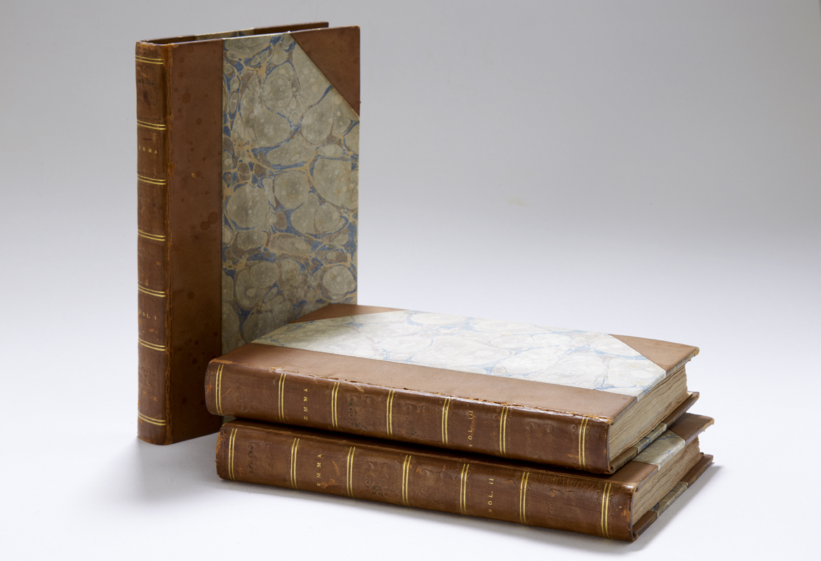 First edition of Emma in three volumes with marbled cover and gilt leather binding