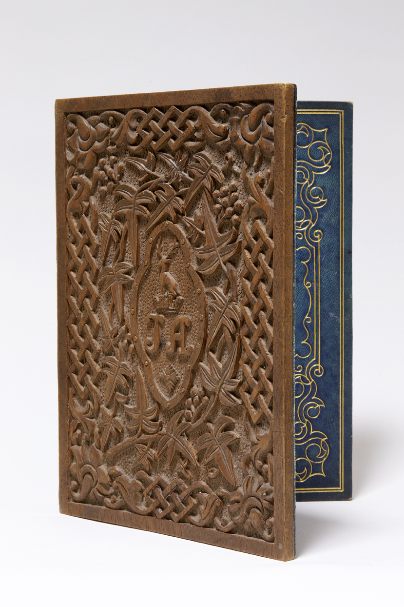 Carved wooden letter case, propped open