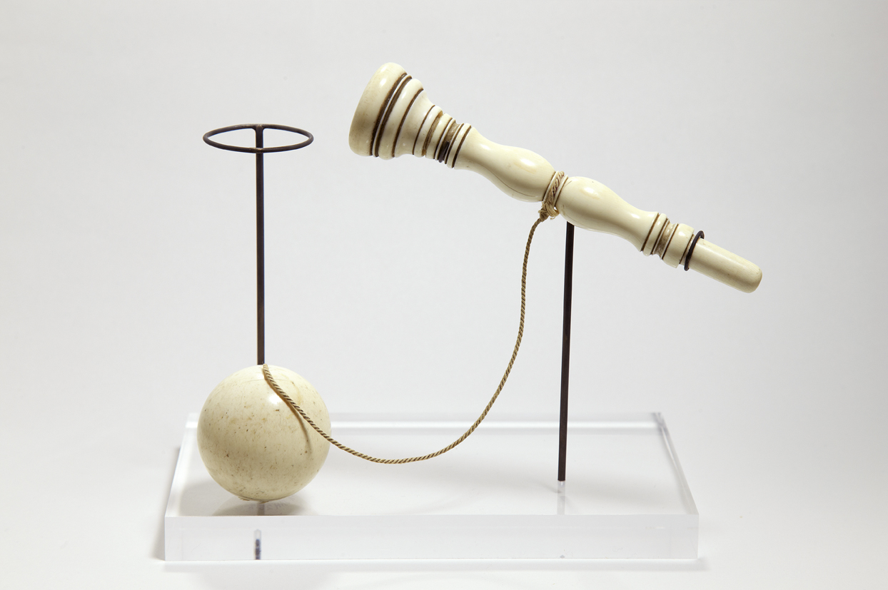 Jane Austen's cup and ball game displayed on a stand