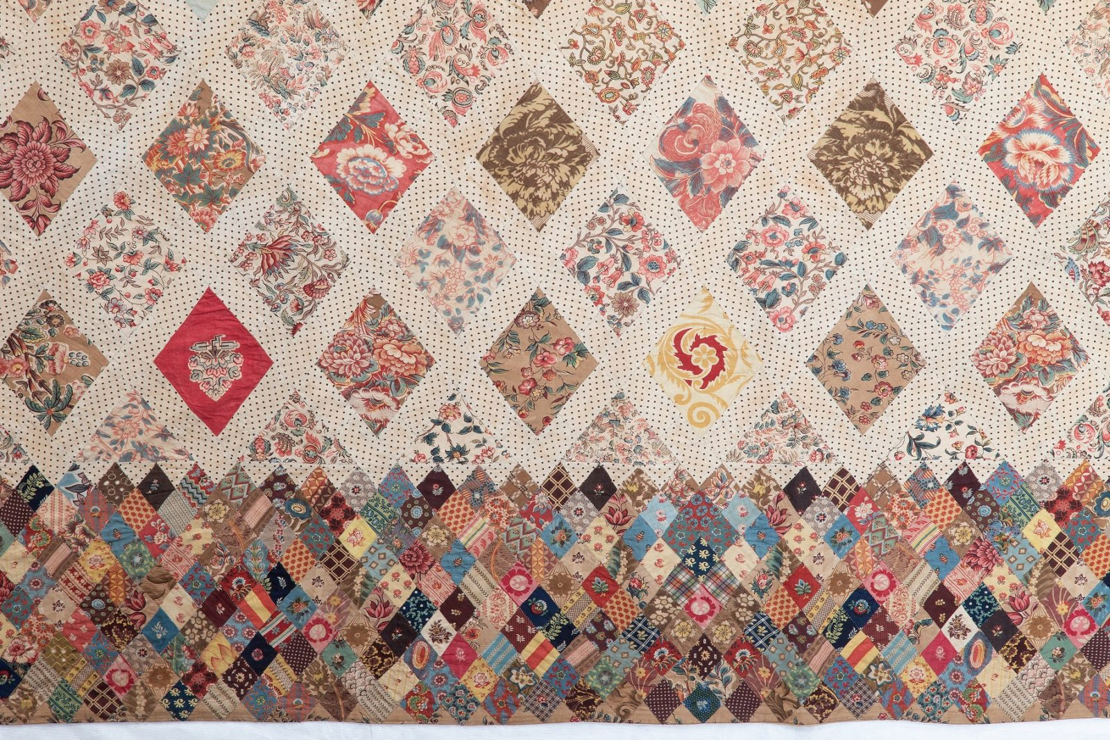 Close up of the Austen family patchwork coverlet, showing border made of small diamonds