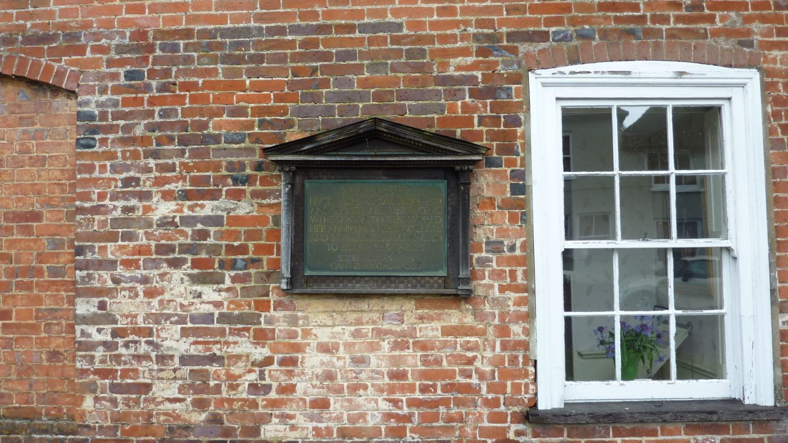 Memorial plaque on the front wall of Jane Austen's House