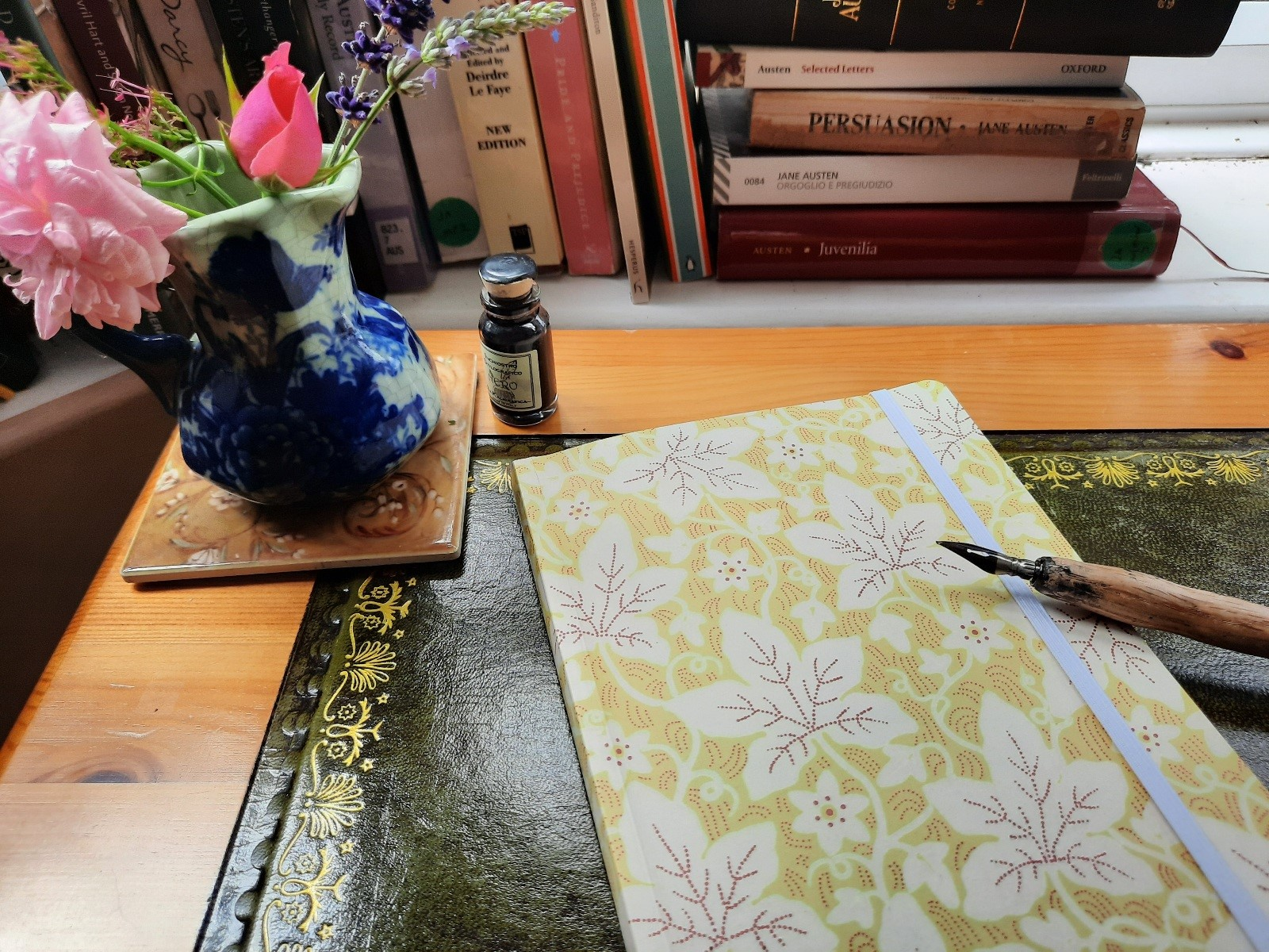 Notebook, pen and lots of Jane's novels