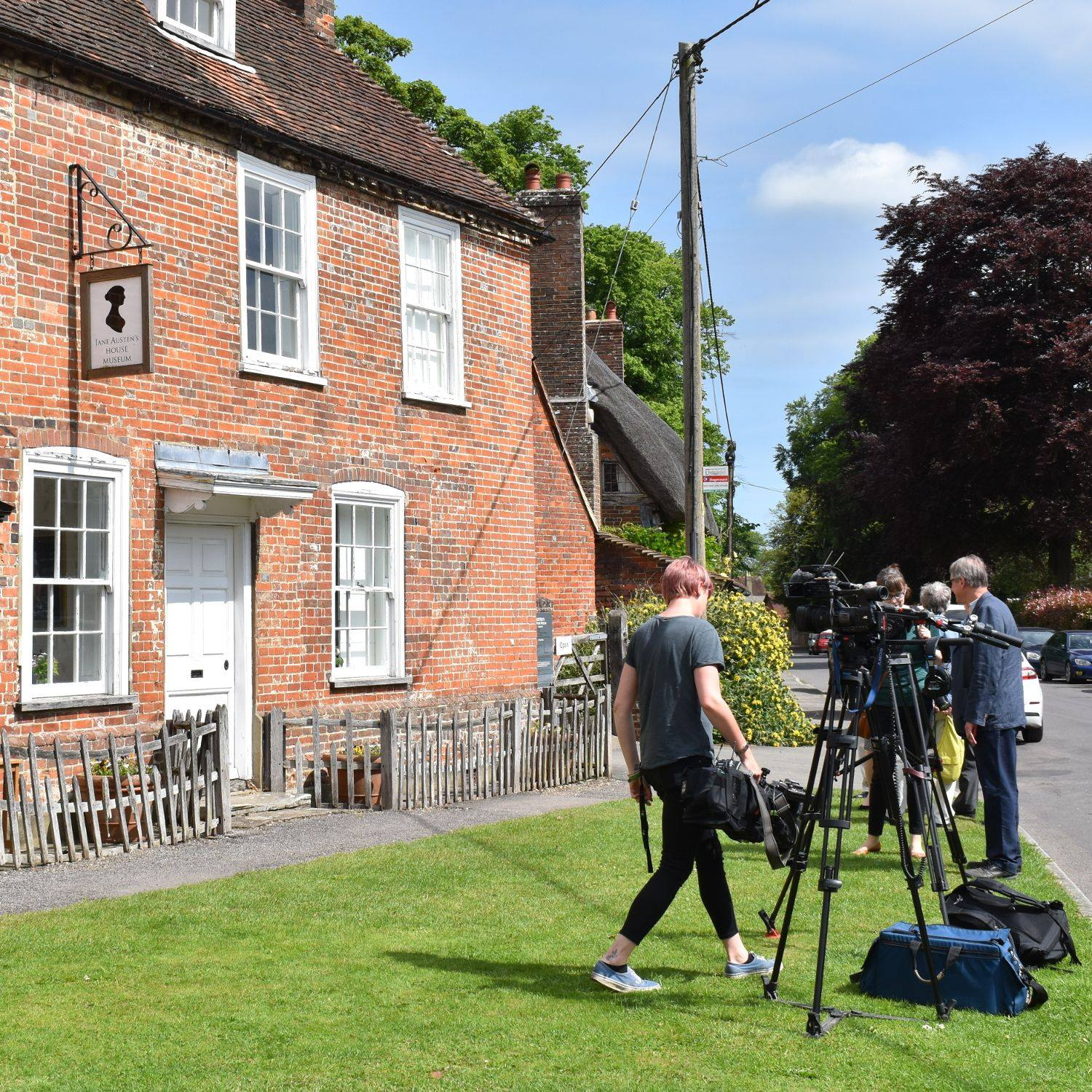 A film crew outside the front of Jane Austen's House