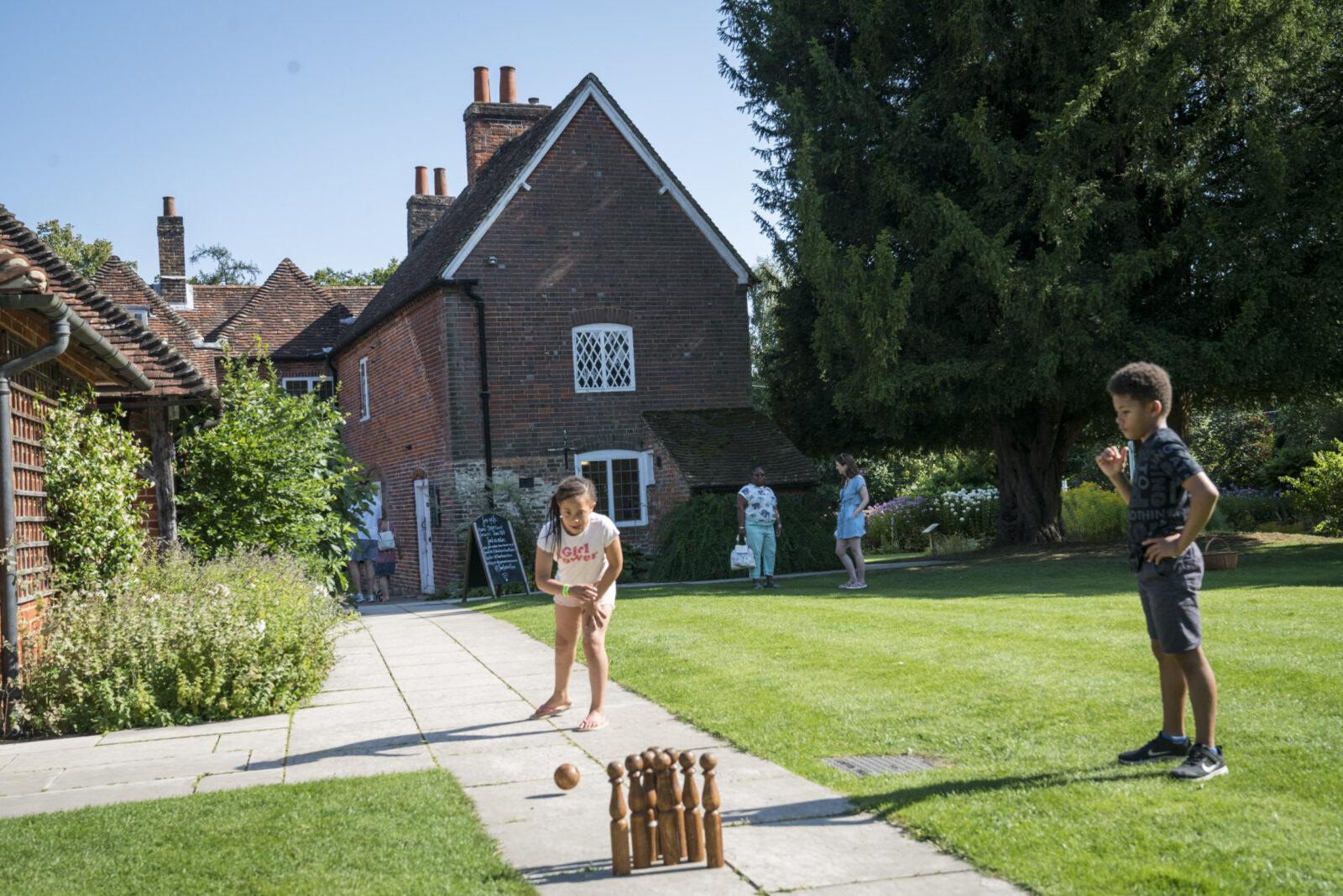 children play in the garden at Jane Austen's House