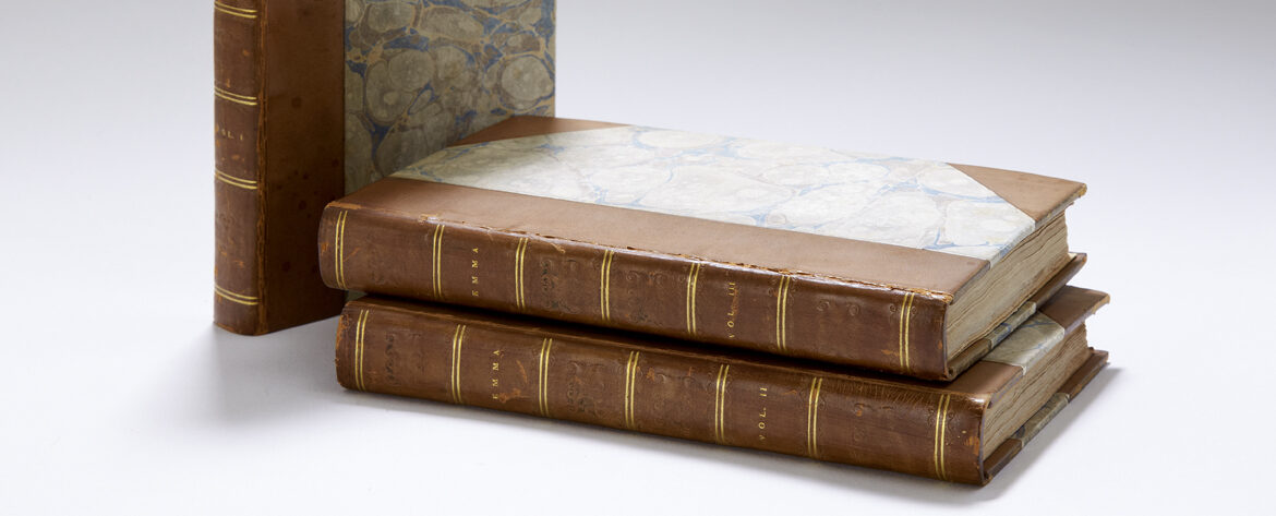 First edition of Emma by Jane Austen, in three volumes. Marbled paper covers