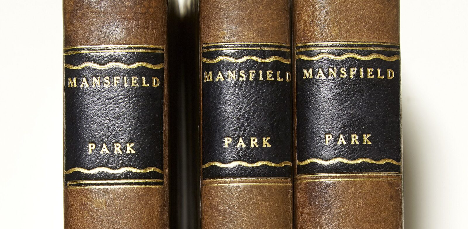 Mansfield Park first edition in three volumes, leather spines