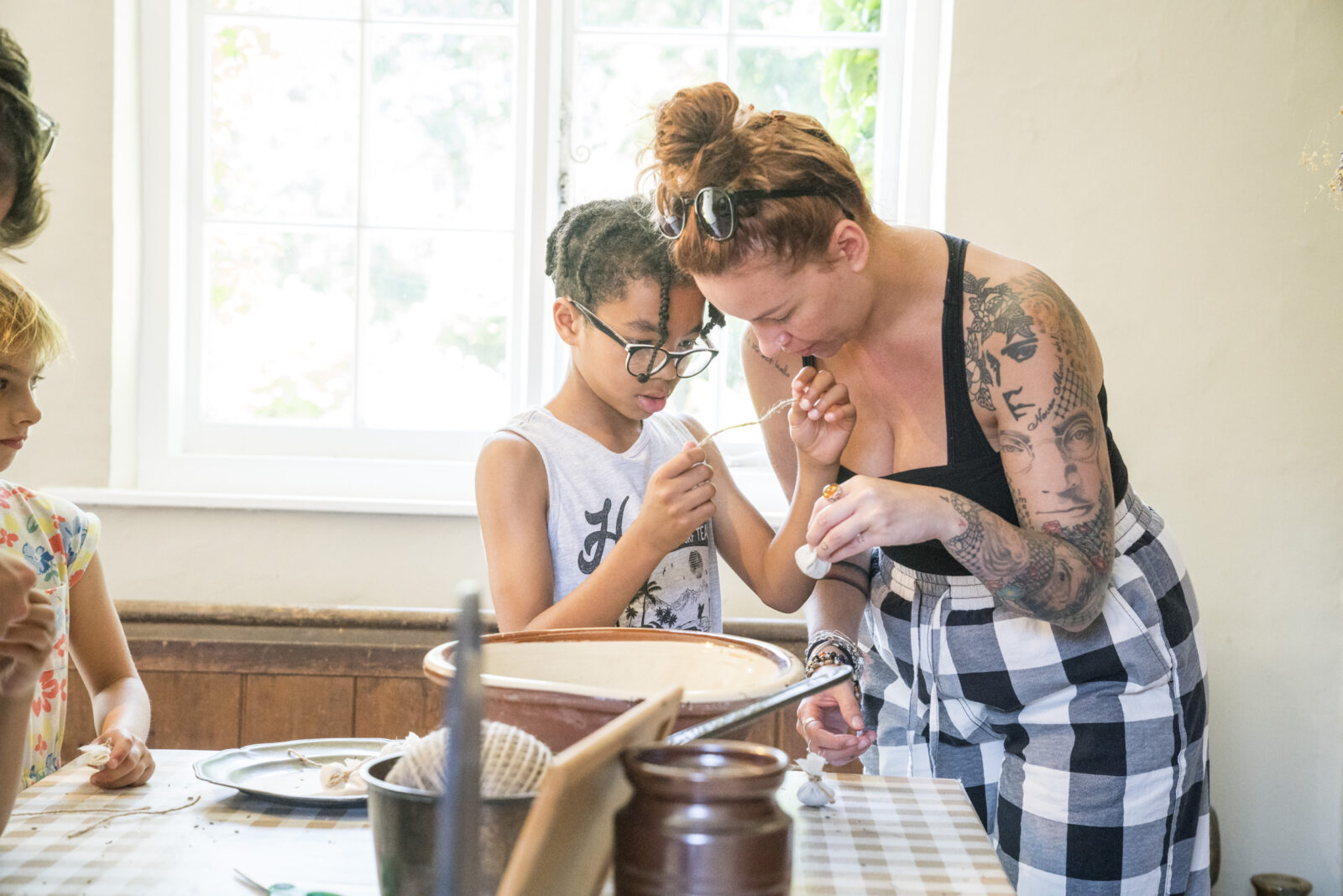 A child and his mother making lavender bags at Jane Austen's House